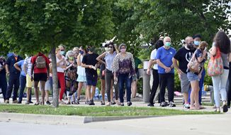 Voters waited patiently in line to cast their ballots in the Kentucky primary at Kroger Field in Lexington, Ky., Tuesday, June 23, 2020. Voter turnout was much heavier than expected leading to wait time of 90 minutes or longer. (AP Photo/Timothy D. Easley)