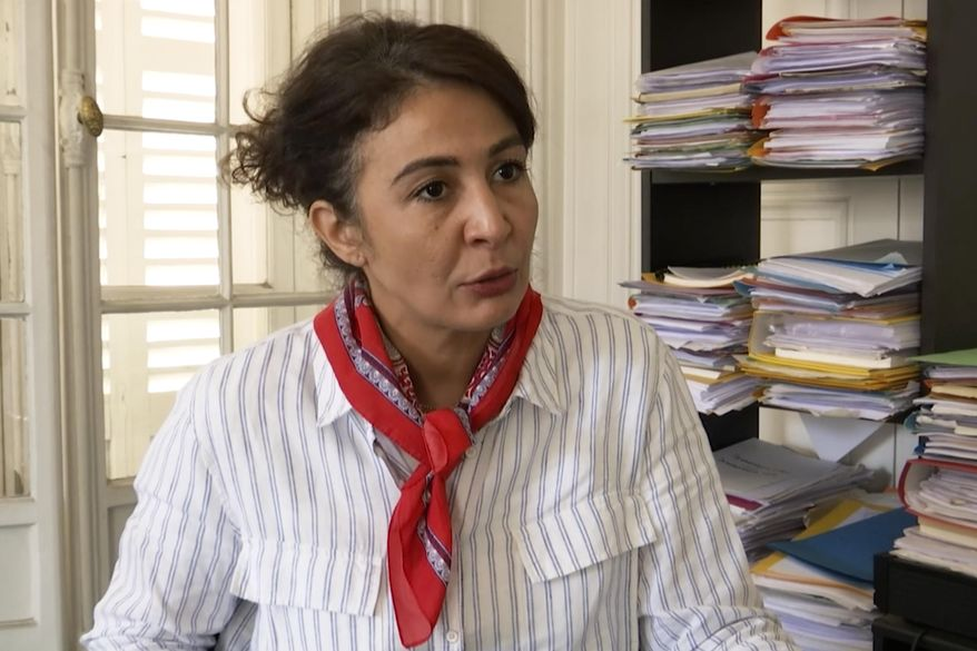In this image taken from video, Doria Chouviat, wife of Cedric Chouviat, talks to the Associated Press in Paris, Tuesday, June 23, 2020. The family of a French delivery driver who died in the wake of a police arrest in January has urged President Emmanuel Macron to ban the use of chokeholds. In an appeal Tuesday, the family of Cedric Chouviat is urging authorities to also suspend the four police officers involved in the arrest. (AP Photo/Alexander Turnbull)