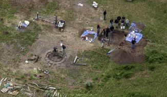 In this Tuesday, June 9, 2020, file aerial photo, investigators search for human remains at Chad Daybell's residence in the 200 block of 1900 east, in Salem, Idaho. Court documents say authorities used cellphone information from the now-deceased uncle of two missing Idaho children to find the youths' bodies on Daybell's rural property. Daybell and the children's mother, Lori Vallow Daybell, are in custody. (John Roark/The Idaho Post-Register via AP, File)