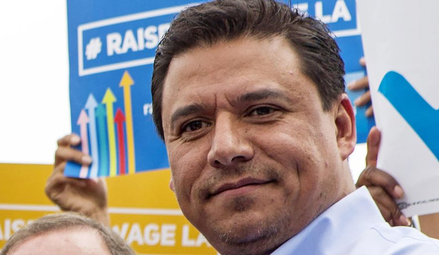 FILE - In this June 13, 2015, file photo Los Angeles City Councilman Jose Huizar is seen at the signing of a minimum-wage ordinance at Martin Luther King Jr. Park in Los Angeles. Huizar, who has been under the cloud of a federal corruption investigation, was arrested Tuesday, June 23, 2020, the FBI said. Councilman Huizar was taken into custody without incident at his Boyle Heights home, said FBI spokeswoman Laura Eimiller. The mayor and other city leaders have been calling for Huizar to resign since his former special assistant agreed to plead guilty in a $1 million bribery scheme involving real estate developers. (AP Photo/Ringo H.W. Chiu, File)