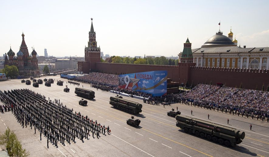 In this Tuesday, May 7, 2019, file photo, Russian military vehicles roll down Red Square during a rehearsal for the Victory Day military parade in Moscow, Russia. A massive military parade that was postponed by the coronavirus will roll through Red Square this week to celebrate the 75th anniversary of the end of World War II in Europe, even though Russia is continuing to register a steady rise in infections. (AP Photo/Alexander Zemlianichenko, Pool, File)
