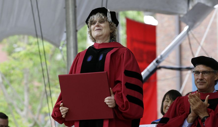 In this May 30, 2019 file photo, Mathematician Ingrid Daubechies is presented with an honorary Doctor of Science degree during Harvard University commencement exercises. An international team of mathematicians whose theories have improved the compression of large digital files of data, including images and sound, will be recognized by one of this year's Princess of Asturias awards, one of the most prestigous in the Spanish-speaking world. The Spanish foundation that organizes the annual awards announced Tuesday that the 2020 prize for Scientific and Technical Investigation will go to Yves Meyer, Ingrid Daubechies, Terence Tao and Emmanuel Candes. (AP Photo/Steven Senne, File)