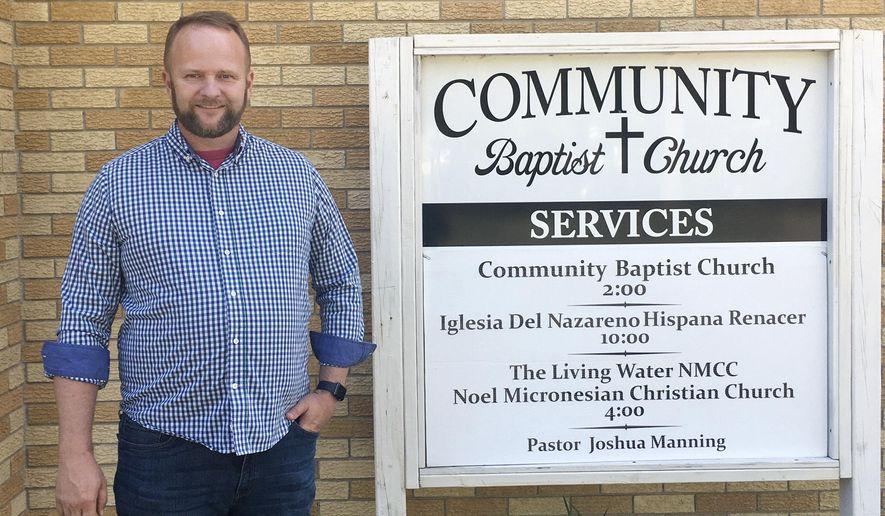 Pastor Joshua Manning poses outside his Community Baptist Church in Noel, Mo. (Lauren Manning via AP)