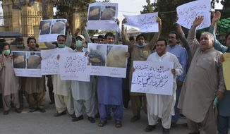"Pakistani journalists rally to condemn the alleged arrests of their colleagues by authorities for reporting lack of facilities in quarantine center set up to contain the spread of coronavirus in border town of Chaman, Tuesday, June 23, 2020 in Quetta, Pakistan. Placard at bottom right reads , ""arrest responsible of torture on journalists."" (AP Photo/Arshad Butt)"
