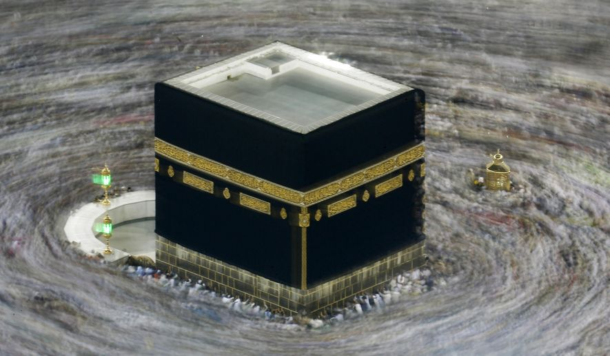 """In this Aug. 13, 2019, file photo taken with slow shutter speed, Muslim pilgrims circumambulate the Kaaba, the cubic building at the Grand Mosque, during the hajj pilgrimage in the Muslim holy city of Mecca, Saudi Arabia. Saudi Arabia says this year's hajj will not be canceled, but that due to the coronavirus only """"very limited numbers"""" of people will be allowed to perform the major Muslim pilgrimage. The kingdom said Monday, June 22, 2020, that only people of various nationalities already residing in the country would be allowed to perform the hajj. (AP Photo/Amr Nabil, File)"""