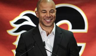 In this July 30, 2018, file photo, former Calgary Flames hockey team captain Jarome Iginla announces his retirement from the NHL at a news conference in Calgary, Alberta. Iginla, the first Black player to lead the NHL in points and goals and to win an Olympic gold medal, is expected to headline the Hockey Hall of Fame's 2020 induction class, to be announced Wednesday, June 24, 2020. (Jeff McIntosh/The Canadian Press via AP) ** FILE **