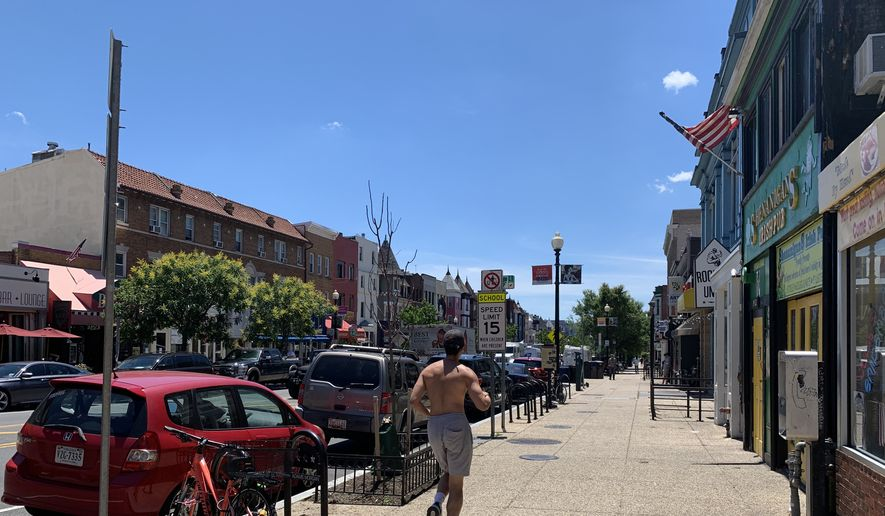 The District's 18th Street NW in Adams Morgan will become a pedestrian plaza on Friday afternoon, June 26, 2020, as the city shuts down the area to vehicles to create a space for outdoor dining and social distancing. (Sophie Kaplan / The Washington Times)