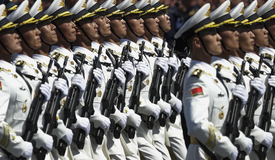 Soldiers of China's People's Liberation Army march in Red Square during the Victory Day military parade marking the 75th anniversary of the Nazi defeat in WWII, in Moscow, Russia, Wednesday, June 24, 2020. The Victory Day parade normally is held on May 9, the nation's most important secular holiday, but this year it was postponed due to the coronavirus pandemic. (AP Photo/Pavel Golovkin, Pool)