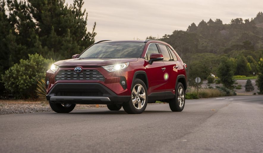 This undated photo from Toyota shows the RAV4 Hybrid, a small SUV that gets an EPA-estimated 40 mpg in mixed driving conditions. Toyota is well versed in making hybrids, and the RAV4 Hybrid is an excellent example. Its cargo space, among the largest in the small SUV class, checks in at 37.5 (minimum) and 69.8 (maximum) cubic feet. (Courtesy of Toyota Motor Sales U.S.A. via AP)