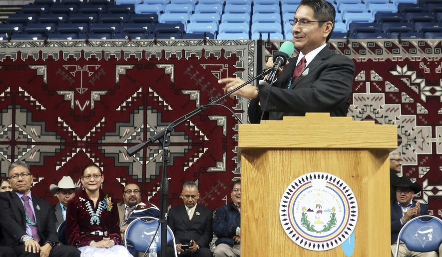 FILE - In this Jan. 15, 2019, file photo, Jonathan Nez addresses a crowd after he was sworn in as president of the Navajo Nation in Fort Defiance, Ariz. Nez, the leader of one of the largest Native American tribes in the U.S. called Wednesday, June 23, 2020, on New Mexico Gov. Michelle Lujan Grisham to end efforts to fight a court ruling that orders improvements in education for members of his tribe and other vulnerable groups. The comments from Nez come ahead of a court hearing next week in which Gov. Grisham will ask a state judge to dismiss a consolidated lawsuit representing Native American and Hispanic plaintiffs. (AP Photo/Felicia Fonseca, File)