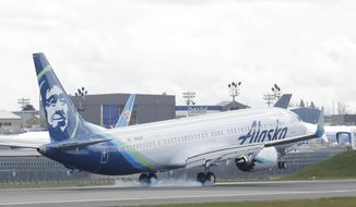 FILE - In a Monday, March 23, 2020 file photo, an Alaska Airlines Boeing 737-9 Max lands at Paine Field near Boeing's manufacturing facility in Everett, Wash., north of Seattle. U.S. regulators are requiring inspections and possible repairs to engine coverings of all Boeing 737 Max jets. That's because of a problem that regulators say could lead to loss of engine power. The problem isn't related to a system suspected in two deadly crashes involving Max planes, but it's another blow to the company's safety reputation.  (AP Photo/Ted S. Warren, File)