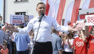FILE - In this Wednesday, June 17, 2020 file photo, Polish President Andrzej Duda waves to supporters as he campaigns for a second term in Serock, Poland.Polands current President Andrzej Duda is the frontrunner ahead of the election on Sunday, June 28, but polls show him unlikely to achieve the majority needed to win outright. That will require a runoff two weeks later in which he is expected to face off against Warsaw Mayor Rafal Trzaskowski in a very close race. (AP Photo/Czarek Sokolowski, file)