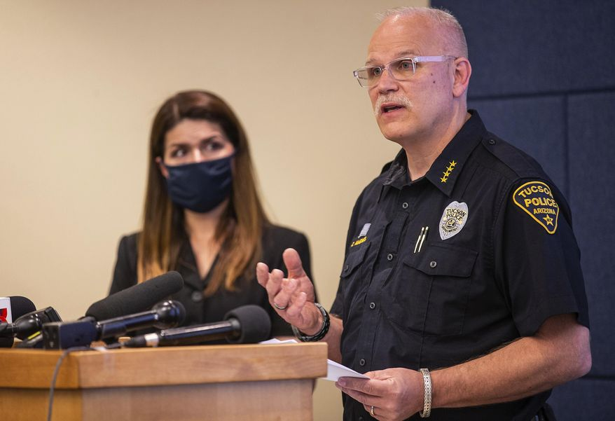 Tucson Police Chief Chris Magnus, right, speaks as Mayor Regina Romero listens during a press conference, Wednesday, June 24, 2020, in Tucson, Ariz.  Chief Magnus offered his resignation after the death of a 27-year-old man who died while handcuffed and placed face-down, resulting in the resignation of three officers the chief said had violated department policy. The city council and city manager have to approve resignation. The city council and city manager have to approve resignation. The medical examiner's office didn't determine a manner of death but said Carlos Ingram-Lopez had died of sudden cardiac arrest while intoxicated by cocaine and physically restrained.  (Josh Galemore/Arizona Daily Star via AP) **FILE**