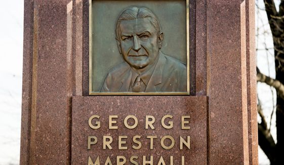 """FILE - In this Dec. 14, 2017, file photo, the George Preston Marshall monument outside RFK stadium in Washington is shown. The Washington Redskins are removing former owner George Preston Marshall from their ring of fame and striking all references to him on their website, a spokesman confirmed Wednesday, June 24, 2020. It's the latest move made to cut ties with the legacy of the team's racist founder, who refused to integrate by signing Black players until """"forced to do so"""" in 1962, more than a decade after the rest of the NFL. (AP Photo/Andrew Harnik, File)"""