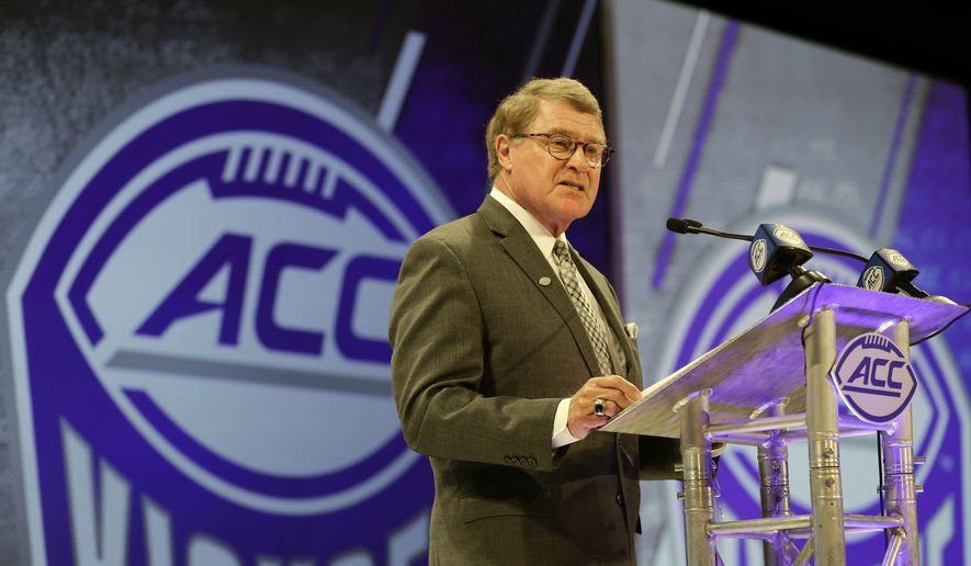 In this July 18, 2018, file photo, Atlantic Coast Conference commissioner John Swofford speaks during a news conference at the ACC NCAA college football media day in Charlotte, N.C. Atlantic Coast Conference Commissioner John Swofford is retiring after the 2020-21 academic year, ending his tenure after 24 years.  Swofford, 71, has been commissioner of the ACC since 1997, the longest run in that position in the history of the 67-year-old conference. (AP Photo/Chuck Burton, File)  **FILE**
