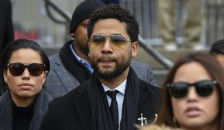 "In this Feb. 24, 2020 file photo, former ""Empire"" actor Jussie Smollett leaves the Leighton Criminal Courthouse in Chicago, after an initial court appearance on a new set of charges alleging that he lied to police about being targeted in a racist and homophobic attack in downtown Chicago early last year. Two brothers who have admitted to helping Smollett stage a racist and homophobic attack in Chicago last year are threatening to stop cooperating with prosecutors. (AP Photo/Matt Marton File)"