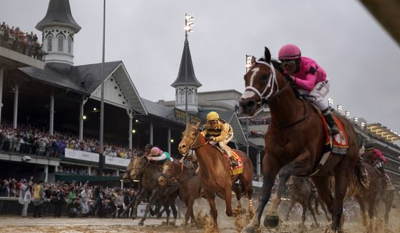 FILE - In this May 4, 2019, file photo, Luis Saez rides Maximum Security, right, across the finish line first against Flavien Prat on Country House during the 145th running of the Kentucky Derby horse race at Churchill Downs in Louisville, Ky. Churchill Downs says the rescheduled Kentucky Derby and Oaks will run this fall with spectators under strict guidelines to limit crowd density for the race that annually attracts more than 100,000. The 146th runnings of the Oaks for fillies and the Derby were postponed from May 1-2 to Sept. 4-5 because of the coronavirus pandemic. Fans will be encouraged to wear masks at all times unless seated and to practice social distancing. (AP Photo/Matt Slocum, File)  **FILE**