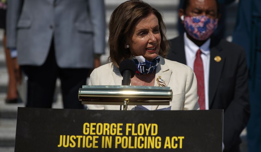 House Speaker Nancy Pelosi of Calif., joined by House Democrats spaced for social distancing, speaks during a news conference on the House East Front Steps on Capitol Hill in Washington, Thursday, June 25, 2020, ahead of the House vote on the George Floyd Justice in Policing Act of 2020. (AP Photo/Carolyn Kaster)