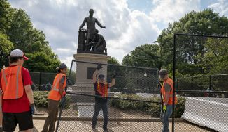Barriers are erected around the Emancipation Memorial in Washington, which depicts a freed slave kneeling at the feet of President Abraham Lincoln, Thursday, June 25, 2020. Calls are intensifying for the removal of the statue as the nation confronts racial injustice. (AP Photo/J. Scott Applewhite)