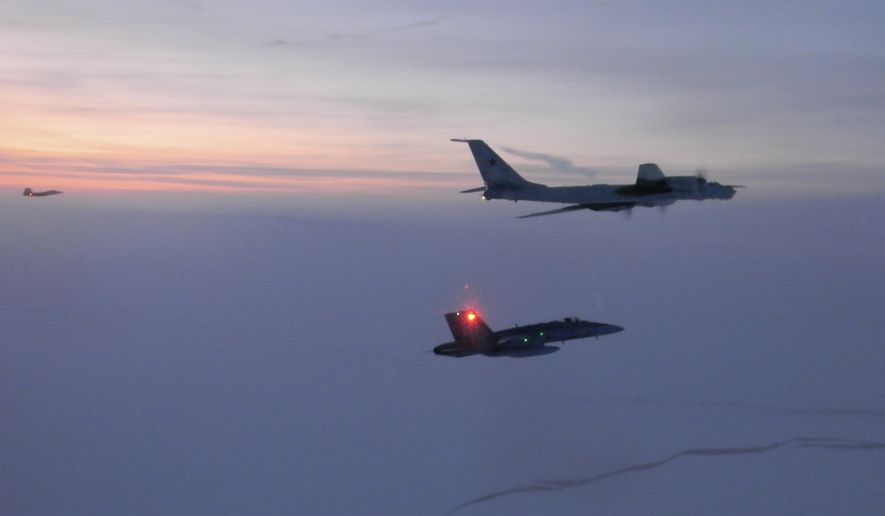 In this Monday, March 9, 2020 file photo released by the North American Aerospace Defense Command (NORAD), a Russian Tu-142 maritime reconnaissance aircraft, top right, is intercepted near the Alaska coastline. Two Russian aircraft that came within 50 miles (80 kilometers) of Unimak Island along Alaska's Aleutian chain were intercepted late Wednesday, June 24, 2020, military officials said Thursday. The incident marked the fifth time this month that such an intercept has taken place, Gen. Terrence J. O'Shaughnessy, commander of the North American Aerospace Defense Command, said in a release. (North American Aerospace Defense Command via AP,File)