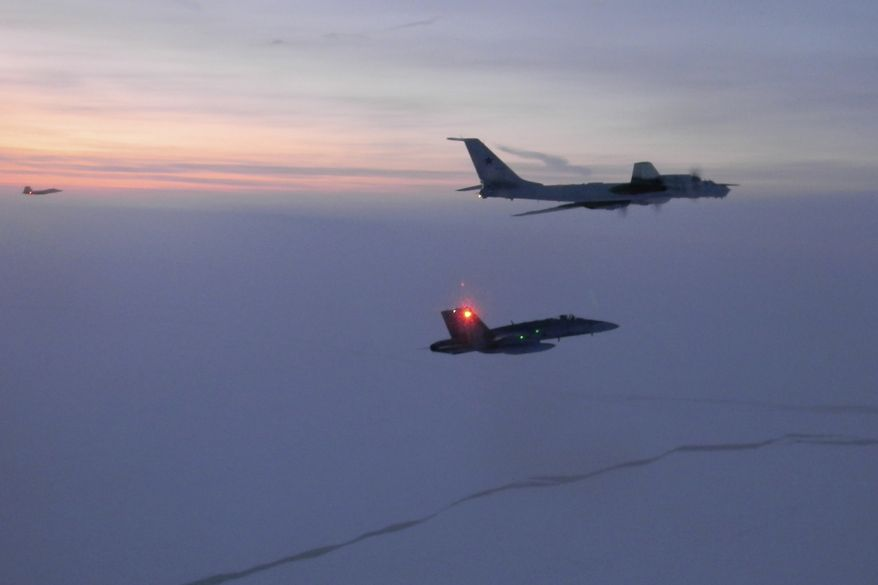 In this Monday, March 9, 2020, file photo released by the North American Aerospace Defense Command (NORAD), a Russian Tu-142 maritime reconnaissance aircraft, top right, is intercepted near the Alaska coastline. Two Russian aircraft that came within 50 miles (80 kilometers) of Unimak Island along Alaska's Aleutian chain were intercepted late Wednesday, June 24, 2020, military officials said the next day. The incident marked the fifth time this month that such an intercept has taken place, Gen. Terrence J. O'Shaughnessy, commander of the North American Aerospace Defense Command, said in a release. (North American Aerospace Defense Command via AP, File)