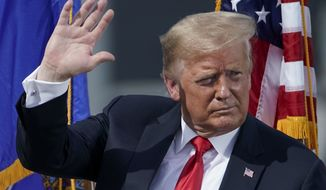 President Donald Trump leaves the stage after speaking at an event at Fincantieri Marinette Marine Thursday, June 25, 2020, in Marinette, Wis. (AP Photo/Morry Gash)