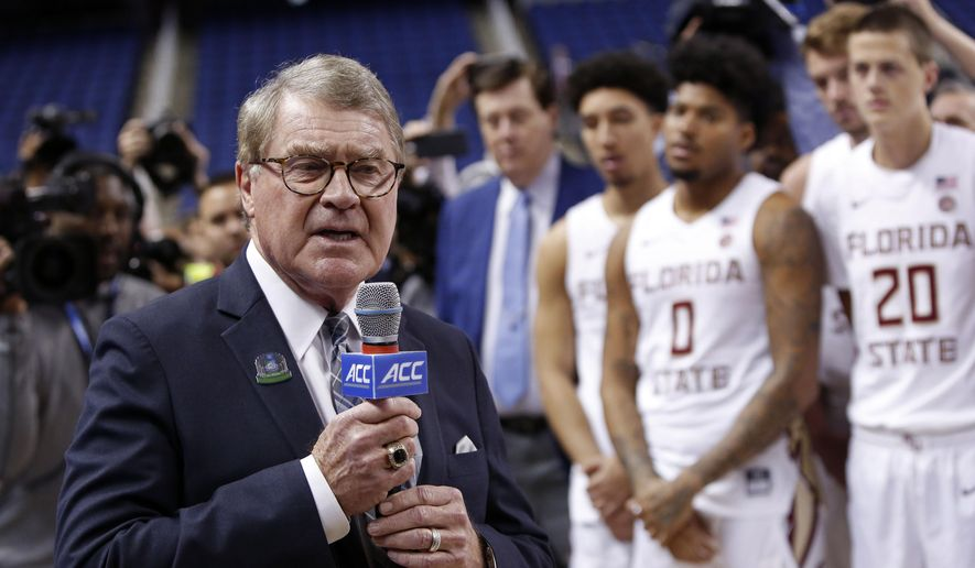 """In this March 12, 2020, file photo, John Swofford, commissioner of the Atlantic Coast Conference, announces the cancellation of NCAA college basketball games at the ACC tournament in Greensboro, N.C. The Power Five conferences spent $350,000 on lobbying in the first three months of 2020, more than they had previously spent in any full year, as part of a coordinated effort to influence Congress on legislation affecting the ability of college athletes to earn endorsement money. """"In this particular case, the (Power Five) conferences are working together on this so that there's less confusion, not more, in terms of the messaging to congressional leaders that helps explain NIL (Names, Images and Likenesses) and what the concerns are, and how it might work,"""" Swofford told The Associated Press. (AP Photo/Ben McKeown) ** FILE **"""
