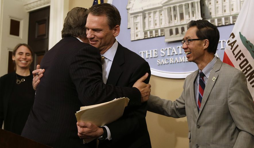FILE - In this June 28, 2018, file photo, State Sen. Bob Hertzberg, D-Van Nuys, left, and Assemblyman Ed Chau, D-Arcadia, right, celebrate with Alastair Mactaggart, center, after the Legislature approved their data privacy bill in Sacramento, Calif. California voters will decide a ballot measure this November that would give them more power over how companies use their data, an extension of a landmark privacy law passed in 2018. Secretary of State Alex Padilla announced Wednesday, June 25, 2020, a measure to amend the law will be on the Nov. 3 general election ballot. (AP Photo/Rich Pedroncelli, File)