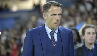 FILE - In this file photo dated Wednesday, March 7, 2018, England head coach Phil Neville walks onto the field before a SheBelieves Cup women's soccer match against the United States, in Orlando, USA.  Neville will step down from coaching the England women's team when his contract expires next year, it is announced Friday April 24, 2020, missing out on leading the country at the rescheduled European Championship in 2022. (AP Photo/Phelan M. Ebenhack, FILE)