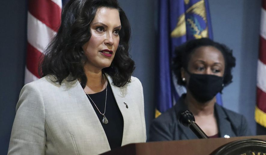 In this June 17, 2020, pool file photo provided by the Michigan Office of the Governor, Michigan Gov. Gretchen Whitmer speaks in Lansing, Mich. A federal appeals court late Wednesday, June 24, 2020, halted a lower judge's ruling and kept closed gyms and fitness centers that Whitmer ordered shut months ago to curb the coronavirus. (Michigan Office of the Governor via AP, Pool) **FILE**