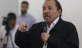 FILE - In this May 16, 2018 file photo, Nicaragua's President Daniel Ortega speaks at the opening of a national dialogue, in Managua, Nicaragua. Ortega spoke in a nationally televised address on Monday, May 18, 2020, and blamed health monitoring measures taken by Costa Rica for his country's decision to close their two border crossings. The dispute boiled over since Costa Rica began May 8 testing all truck drivers entering the country for COVID-19. (AP Photo/Alfredo Zuniga, File)