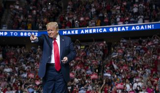 In this June 20, 2020, photo, President Donald Trump arrives on stage to speak at a campaign rally at the BOK Center in Tulsa, Okla. President Donald Trump is sharpening his focus on his ardent base of supporters as polls show a diminished standing for the president in battleground states that will decide the 2020 election (AP Photo/Evan Vucci) ** FILE **