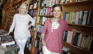 In this Thursday, June 25, 2020, photo, novelist Ann Patchett, right, and her business partner, Karen Hayes, left, pose in their independent bookstore, Parnassus Books, in Nashville, Tenn. Their bookstore that opened and thrived while others were closing their doors is once again defying the odds during the coronavirus pandemic. (AP Photo/Mark Humphrey)