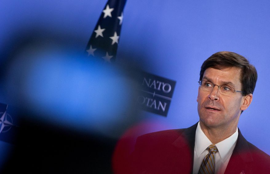 Defense Secretary Mark Esper, who has had his own public friction recently with the commander in chief, is trying to avoid getting pulled into a political battle with lawmakers who say President Trump is driving hirings, firings and promotions inside the Pentagon. (AP Photo/Virginia Mayo, Pool)