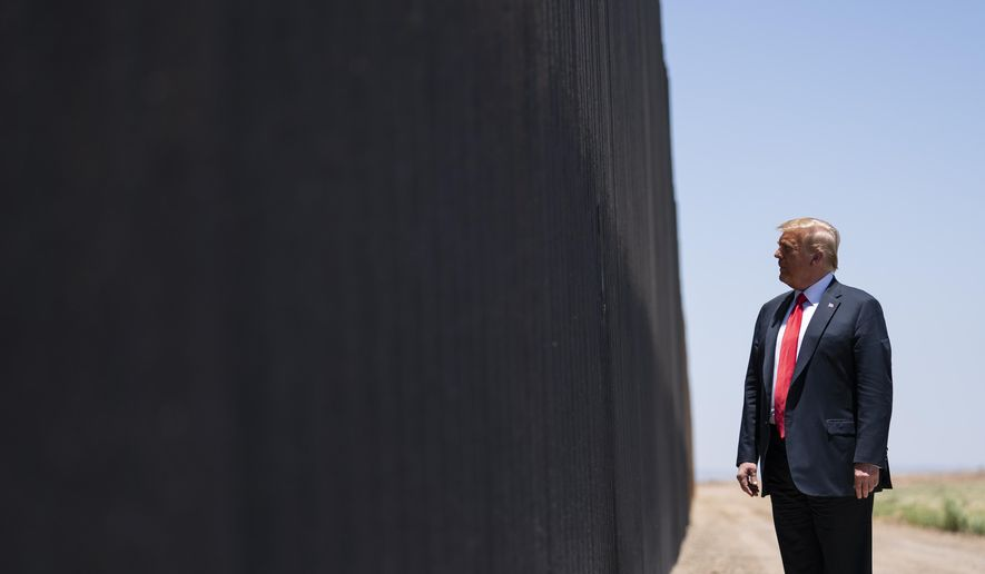 In this June 23, 2020, photo, President Donald Trump tours a section of the border wall in San Luis, Ariz. (AP Photo/Evan Vucci) **FILE**