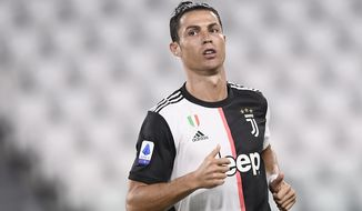 Juventus' Cristiano Ronaldo in action during the Serie A soccer match between Juventus and Lecce, at the Allianz Stadium in Turin, Italy, Friday, June 26, 2020. (Fabio Ferrari/LaPresse via AP)