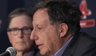 FILE - In this Jan. 15, 2020, file photo, Boston Red Sox baseball team owner John Henry, left, listens as chairman Tom Werner speaks during a news conference at Fenway Park in Boston. Liverpool won its first league title since 1990, clinching Thursday, June, 25, 2020. Because of the pandemic, Henry and Werner, who headed the group that bought the team in 2010, watched on television from the U.S. (AP Photo/Elise Amendola, File)