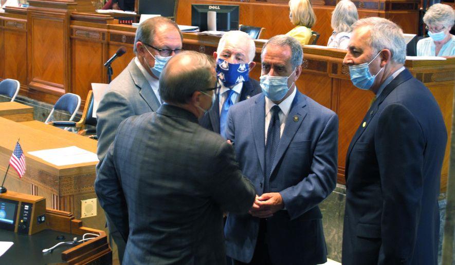 Senators talk on the Senate floor ahead of a debate about Louisiana's budget for the financial year that begins July 1, on Friday, June 26, 2020, in Baton Rouge, La. (AP Photo/Melinda Deslatte)