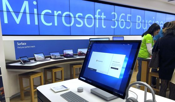 In this Jan. 28, 2020, file photo a Microsoft computer is among items displayed at a Microsoft store in suburban Boston.  Microsoft said Friday, June 26,  it is permanently closing nearly all of its physical stores around the world. Like other retailers, the software and computing giant had to temporarily close all of its stores in late March due to the COVID-19 pandemic. (AP Photo/Steven Senne, File)  **FILE**