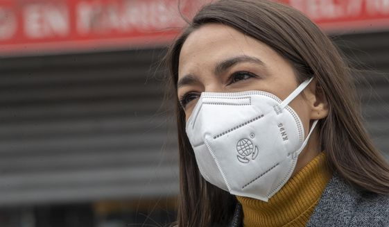 In this Tuesday, April 14, 2020 file photo, Rep. Alexandria Ocasio-Cortez, D-N.Y., wears a face mask during a news conference to call on FEMA to grant approval for Disaster Funeral Assistance to help families in lower-income communities and communities of color across New York amid the COVID-19 coronavirus pandemic, in the Corona neighborhood of the Queens borough of New York. (AP Photo/Mary Altaffer)