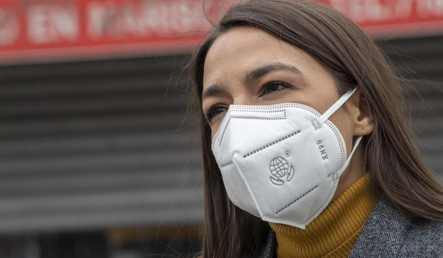 In this Tuesday, April 14, 2020, file photo, Rep. Alexandria Ocasio-Cortez, D-N.Y., wears a face mask during a news conference to call on FEMA to grant approval for Disaster Funeral Assistance to help families in lower-income communities and communities of color across New York amid the COVID-19 coronavirus pandemic, in the Corona neighborhood of the Queens borough of New York. (AP Photo/Mary Altaffer)