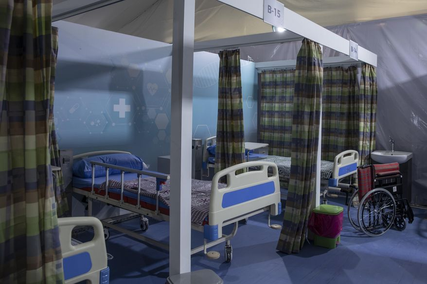 Hospital beds are prepared to receive COVID-19 patients at Ain Shams University Field Hospital in Cairo, Egypt, Wednesday, June 17, 2020. The hospital has a capacity of 179 beds including 11 Intensive Care Units, Dr. Ashraf Omar, dean of the medical school said Wednesday in televised comments. (AP Photo/Nariman El-Mofty)