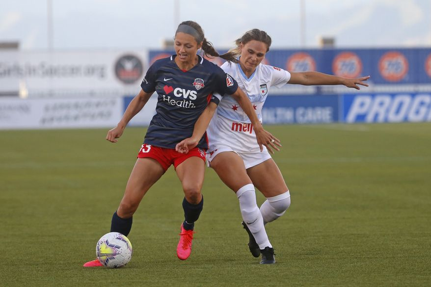 Chicago Red Stars' Bianca St. Georges, right, battles with Washington Spirit forward Ashley Hatch (33) during the first half of an NWSL Challenge Cup soccer match at Zions Bank Stadium, Saturday, June 27, 2020, in Herriman, Utah. (AP Photo/Rick Bowmer) ** FILE **
