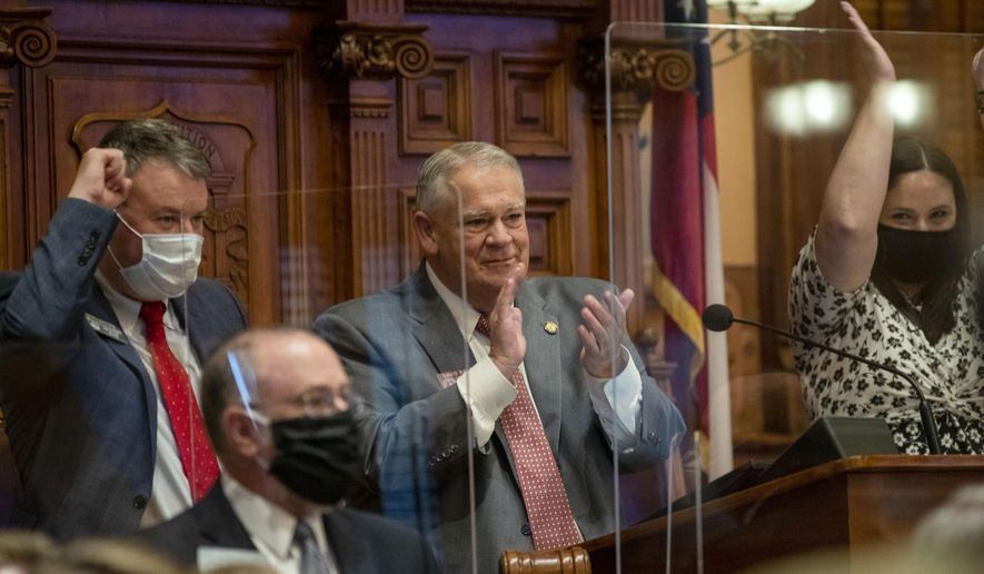 Georgia Speaker of the House David Ralston, R-Blue Ridge, center, congratulates members of the House after they passed HB 793 on Sine Die, day 40, of the legislative session in Atlanta, Friday, June 26, 2020. (Alyssa PointerAtlanta Journal-Constitution via AP)