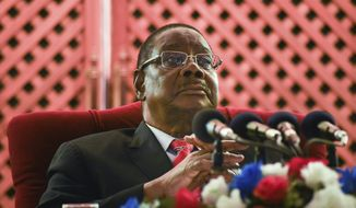 Malawian President Peter Mutharika addresses the media at a news conference in Blantyre, Malawi, Saturday, June 27, 2020. More than 6 million Malawians went to the polls in an election re-run Tuesday, June 23, 2020, after a court overturned last year's election results and ordered a fresh vote. (AP Photo/Thoko Chikondi)