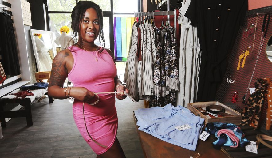 Jasmine Gordon poses for a photo at A La Mode, a clothing store she co-owners with her sister, Angelique Gordon, in Salt Lake City on Wednesday, June 24, 2020. (Scott G Winterton/The Deseret News via AP)