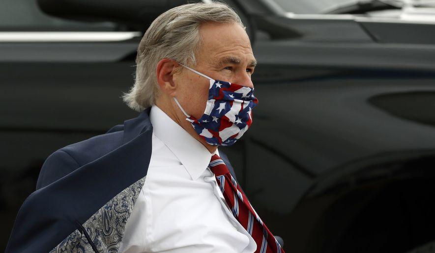 Texas Gov. Greg Abbott arrives to greet Vice President Mike Pence at Love Field in Dallas, Sunday, June 28, 2020. (AP Photo/Tony Gutierrez) **FILE**