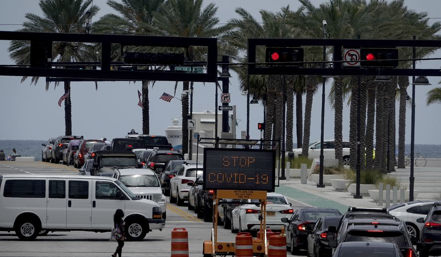 The intersection of A1A and Las Olas is seen Sunday, June 28, 2020. Broward County announced it is joining Miami-Dade County and closing beaches on the July 4 weekend. (Joe Cavaretta /South Florida Sun-Sentinel via AP) ** FILE **