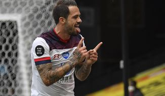 Southampton's Danny Ings celebrates after scoring his second goal of the game during the English Premier League soccer match between Watford and Southampton at the Vicarage Road Stadium in Watford, England, Sunday, June 28, 2020. (Justin Setterfield/Pool via AP)