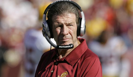 In this Sept. 23, 2007, file photo, Washington Redskins assistant head coach-offensive Joe Bugel looks on during an NFL football game in Landover, Md. Former Redskins assistant coach Bugel has died. He was 80. The team announced that Bugel died on Sunday, June 28, 2020. It did not disclose a cause of death. (AP Photo/Manuel Balce Ceneta, File)  **FILE**